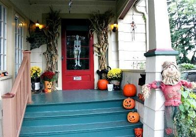 cornstalks and scarecrows on front porch