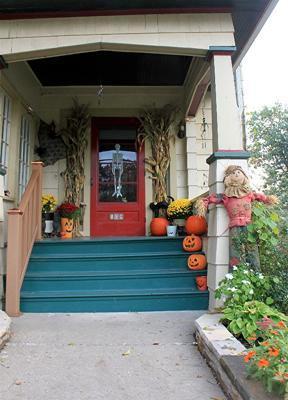 carved pumpkins line front steps