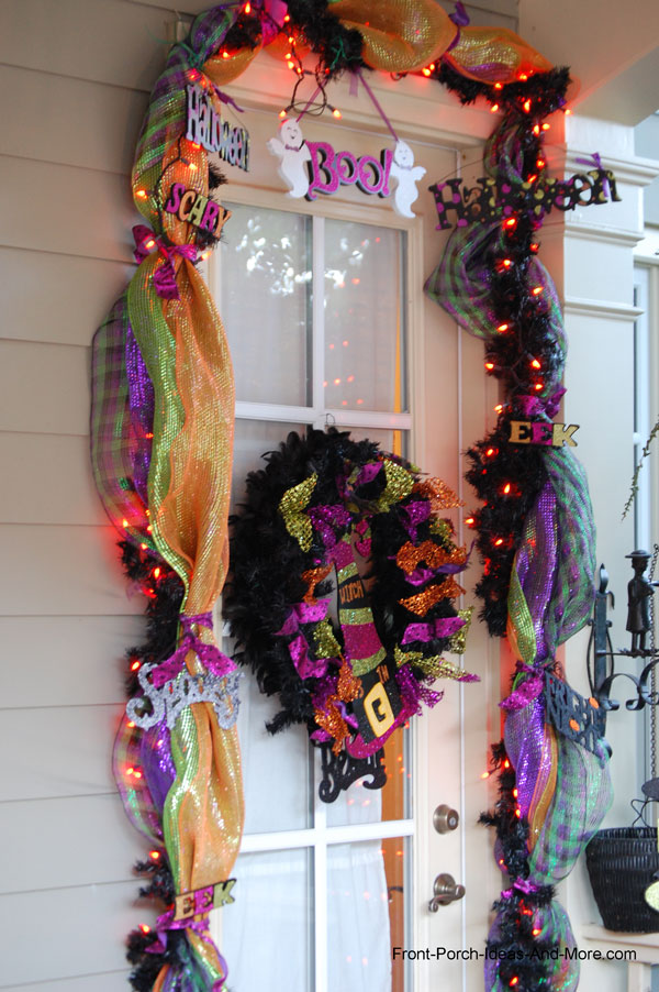 front door decorated for Halloween with garland
