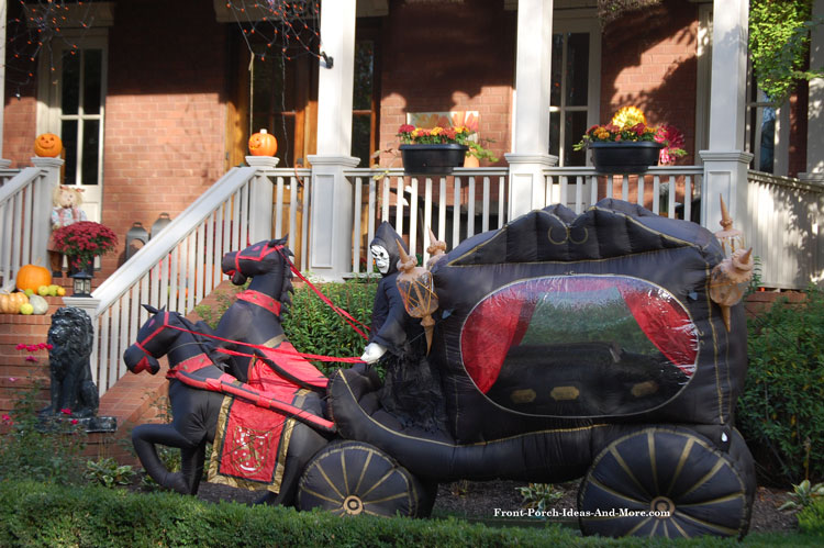 horse drawn halloween hearse inflatable in front of porch