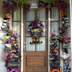 massive halloween garland and wreath on front door
