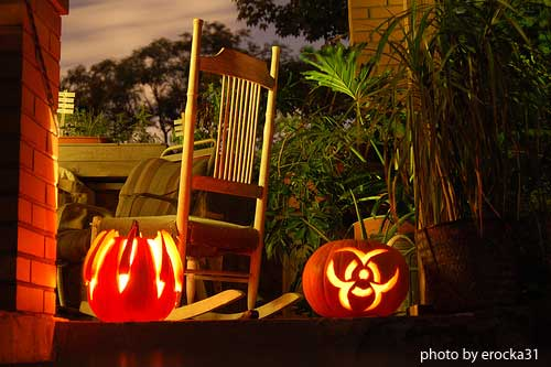 carved lighted pumpkins on front porch