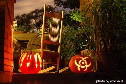 carved lighted pumpkins on front porch