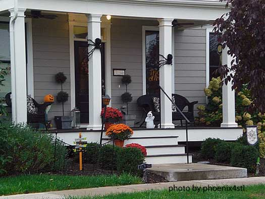 Halloween porch decorating with pumpkins, ghosts, and spiders