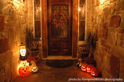 front porch with lighted pumpkins for special effects