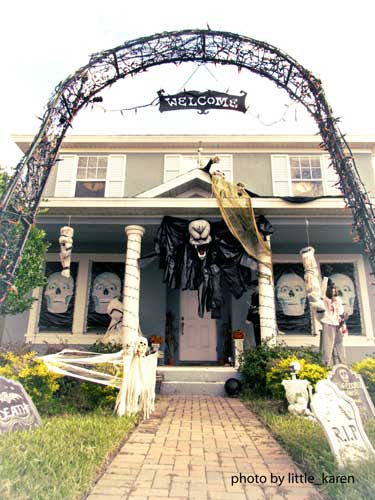 Halloween porch decorating with arched gate and goblins