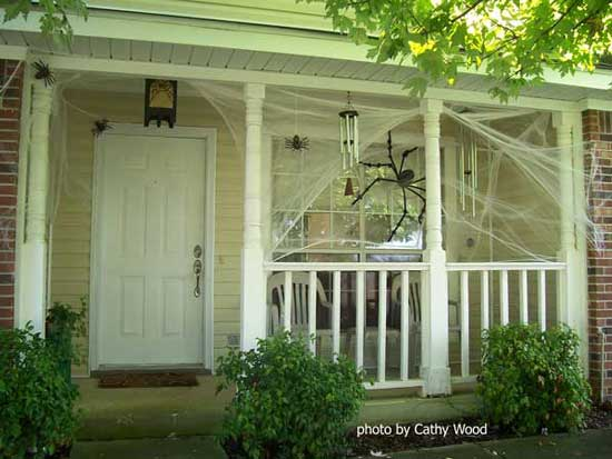 spider web and spider strung between porch columns - Decorating Outside For Halloween