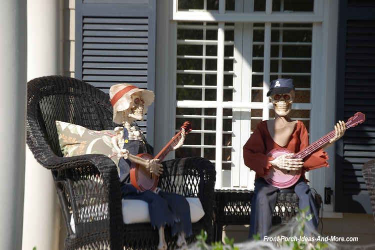 two skeletons playing bangos on porch