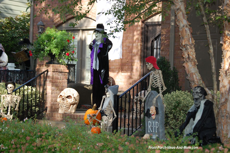 lots of halloween props on porch steps