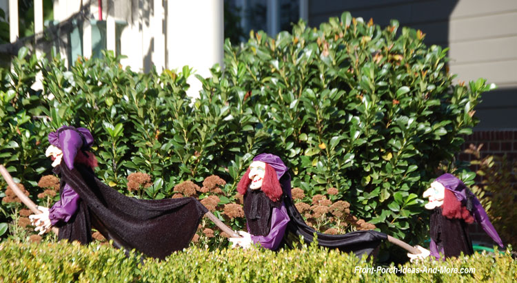 three Halloween witches in yard