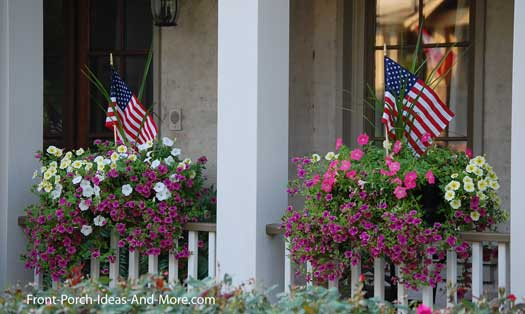 beautiful flower baskets on porch railings