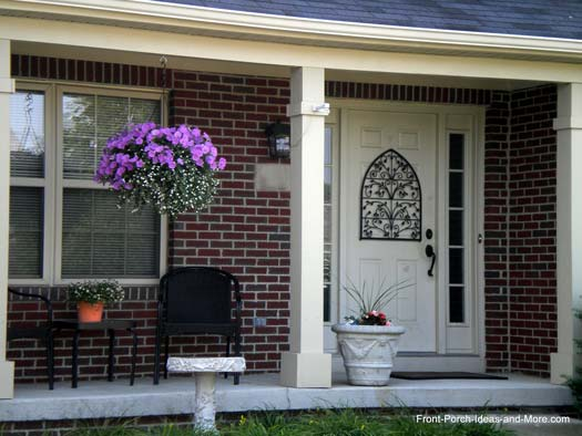 The basket of flowers is focal point of this porch