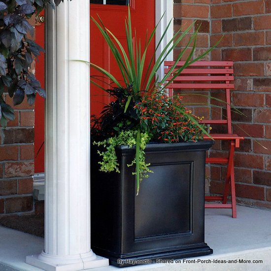 Square polyethylene patio planter at the front door