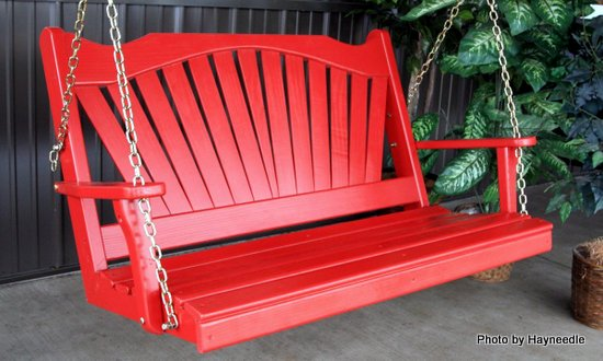 Fan-style back on this red wooden porch swing