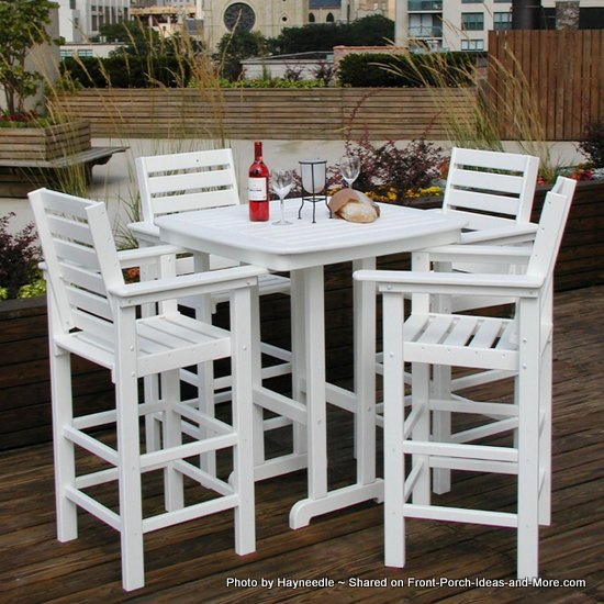 Made from recycled plastic, this bistro set has 4 captain chairs