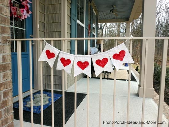 Heart garland on porch inspired by Kara from the Happy Go Lucky Blog