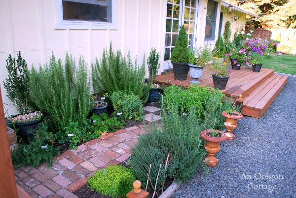 herb garden and brick walkway along back of home