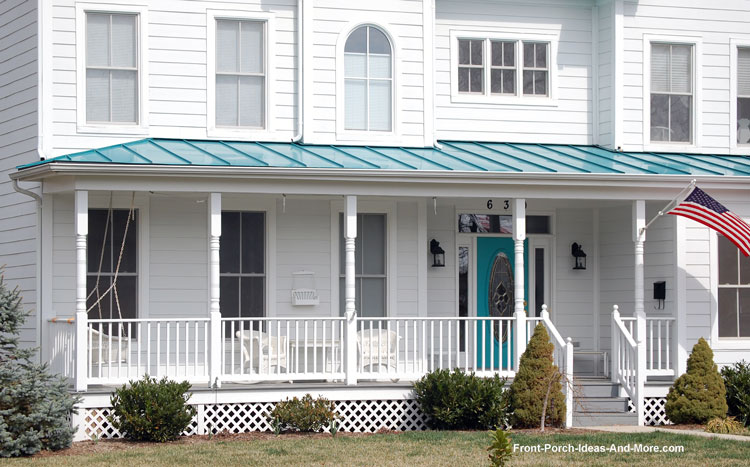 turned porch columns and green standing seam metal roof