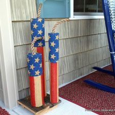 homemade firecracker decorations on front porch