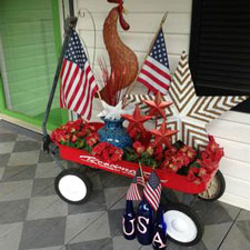 red wagon on front porch decorated for a patriotic holiday