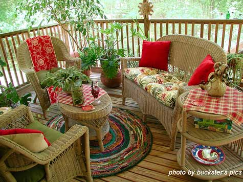 Creative Round Rug Design On Back Porch With Wicker Furniture