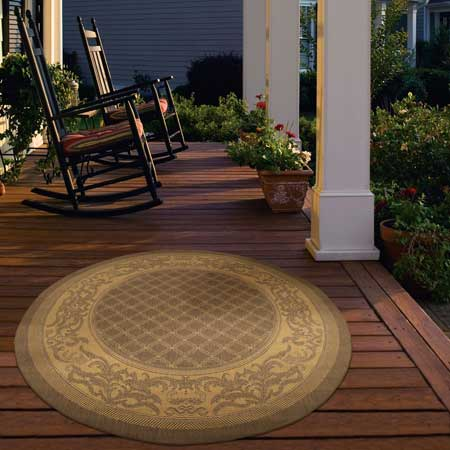 beautiful outdoor rug on front porch with porch swing