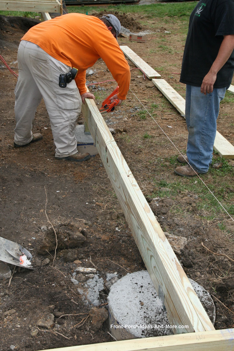 workers installing porch beam