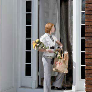woman entering doorway with an instant screen door installed