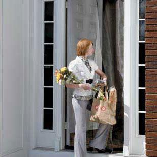 woman entering doorway with an instant screen door installed