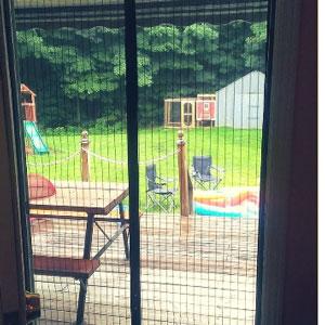instant screen door showing back yard fun