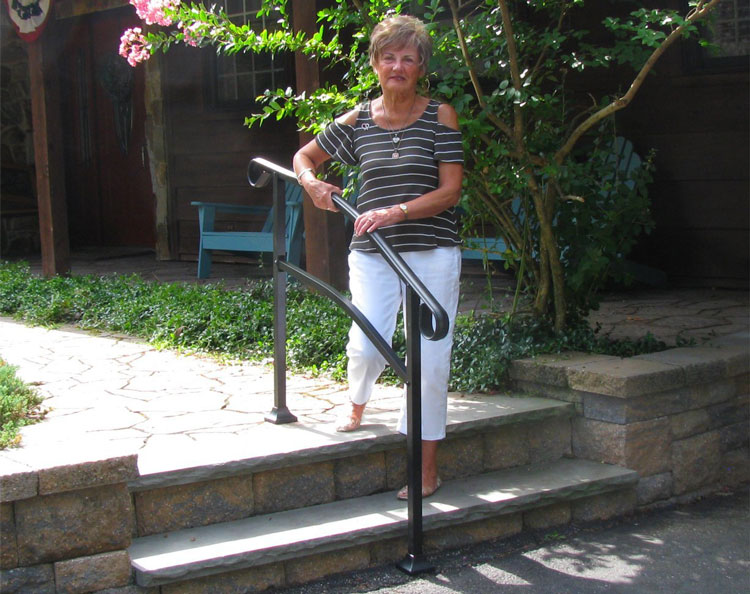 mature woman negotiating steps using handrail