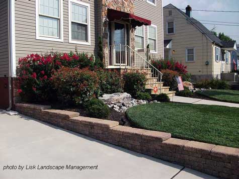 The taller shrubs hide the foundation, provide color, and frame the ...