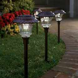 landscape lights along walkway to porch