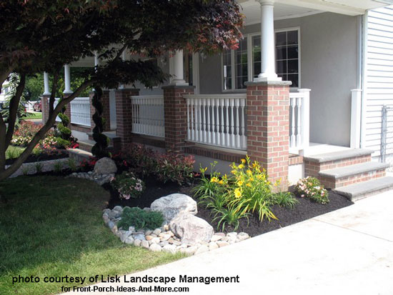 landscaping in front of porch using colorful flowers and rocks