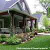 craftsman style porch with rock garden