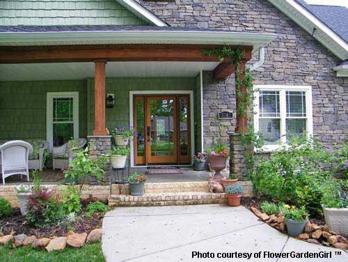 Landscaping with rocks around your porch for Craftsman landscape design ideas