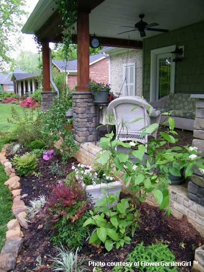 Landscaping with rocks around your porch for Garden decking borders