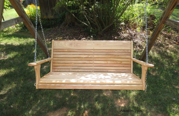 large adult porch swing in yard