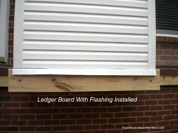 flashing over ledger and ledger board installed
