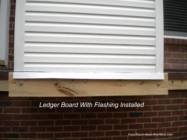 flashing over ledger and ledger board installed