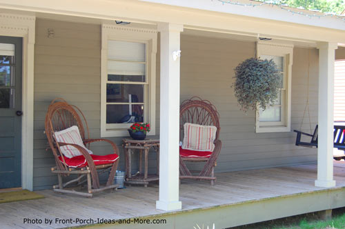 rocking chairs with red cushions on front porch