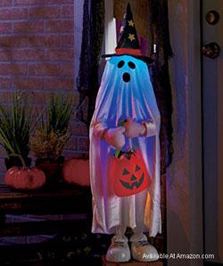 lighted kid ghost holding a pumpkin
