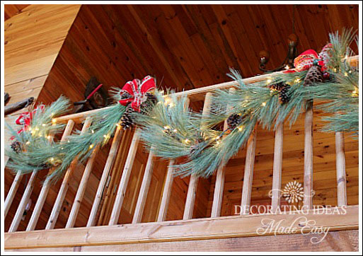 Christmas log cabin - pine garland on loft