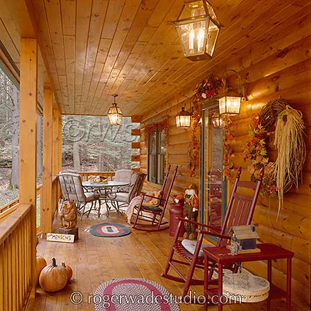 front porch on log home decorated for autumn