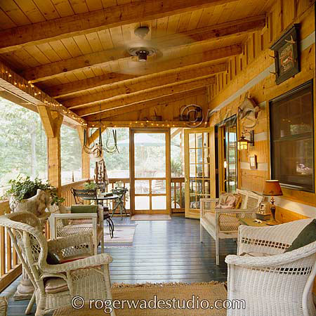 Log home screened in porch with wicker furniture