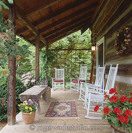 Side porch of log home with rocking chairs