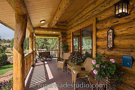 country log home with wrap around front porch