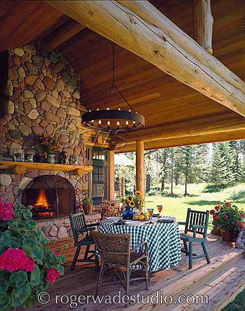 Rustic porch setup on log home