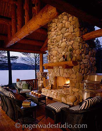stone fireplace on front porch of log home