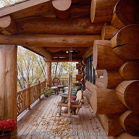 log home porch photo by Roger Wade